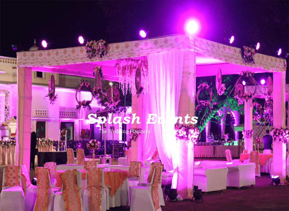 White and peach theme wedding decoration in Taj SMS Convention Centre Jaipur