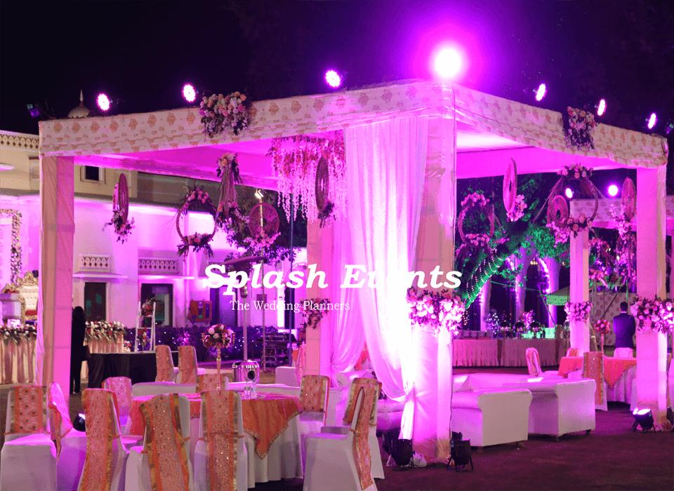 White and peach theme wedding decoration in Taj SMS Convention Centre Jaipur